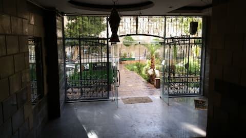 Room with a garden by AUC - Tahrir Square