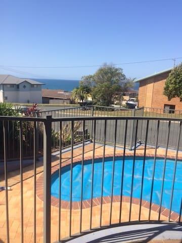 Pool overlooking ocean right outside door of apartment