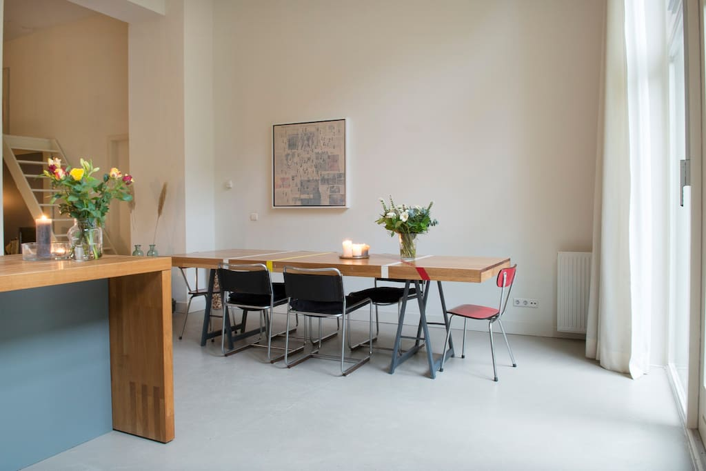 Large dining table made from an old wooden gym floor