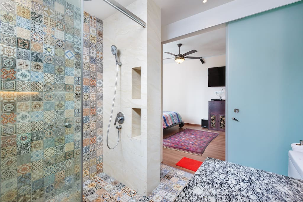 Large shower area with 20 inch rainshower. Alcove available to put your bath items. Glassdoor separates bathroom and bedroom.