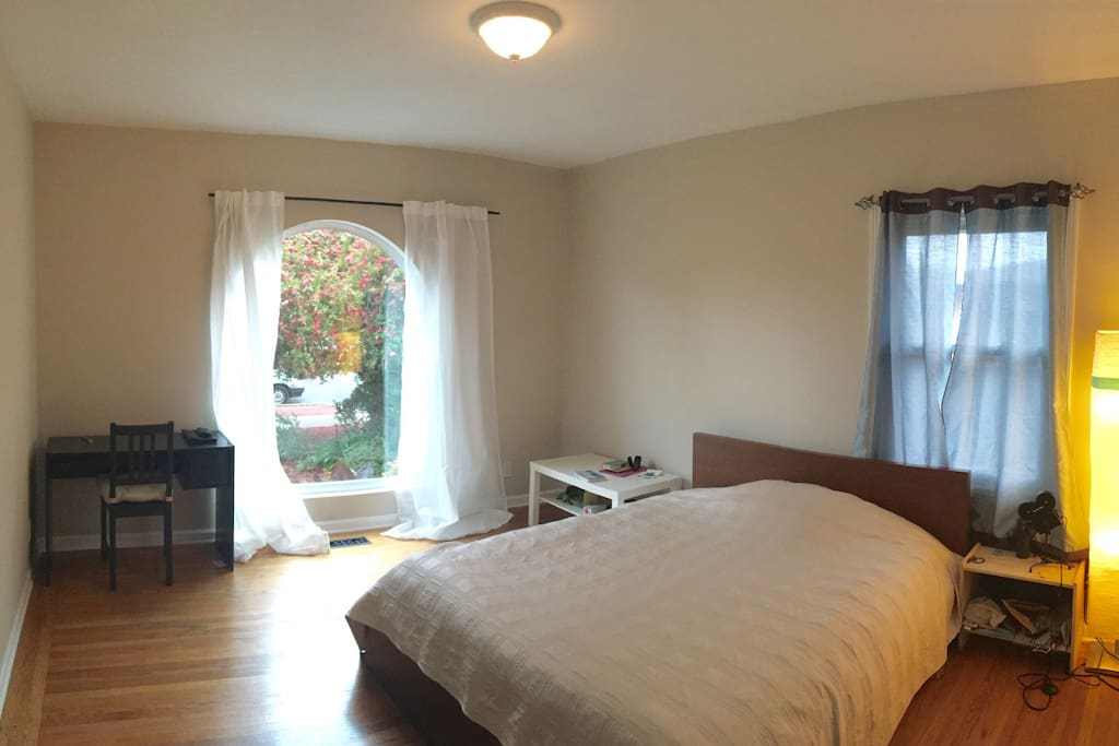Your spacious bedroom with shared bathroom, working desk, huge bed and private storage. Very sunny and cosy.