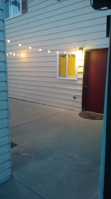 The Cozy Farmhouse's private suite has a separate entrance near the detached garage. It's got its own key and lit patio.