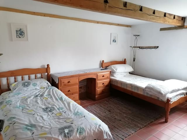 8, Twin bedroom in the stable unit, entrance is to the left of the main door leading off the decked area from the parking courtyard.