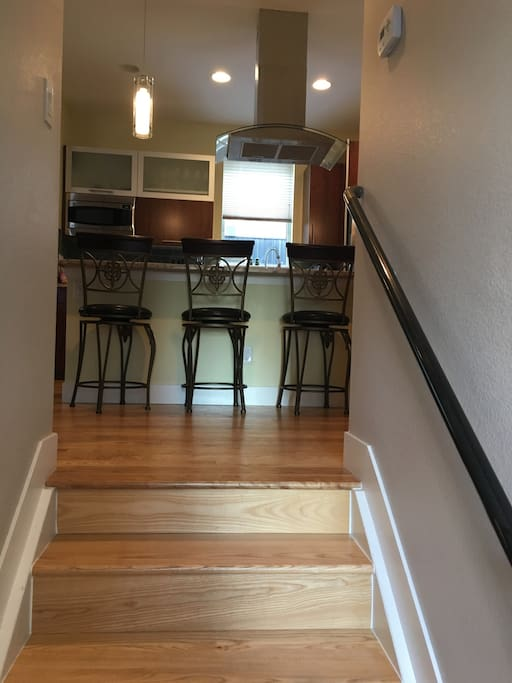 Stairs leading into kitchen