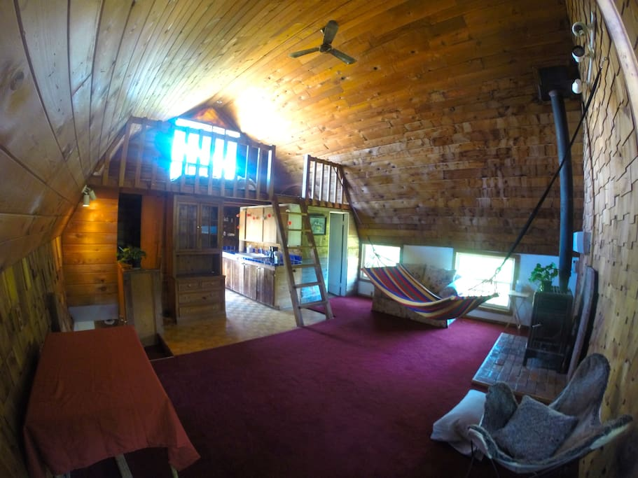 Open main floor with majestic cedar ceiling