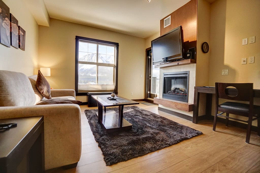 Cozy living room with Cable TV and gas fireplace.