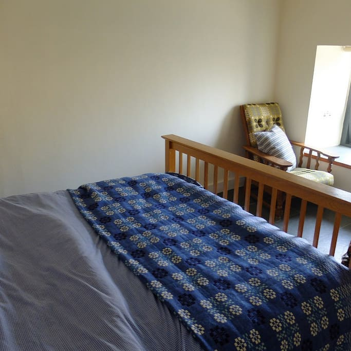 Ramsey's king sized bedroom with en-suite shower room & river views.
