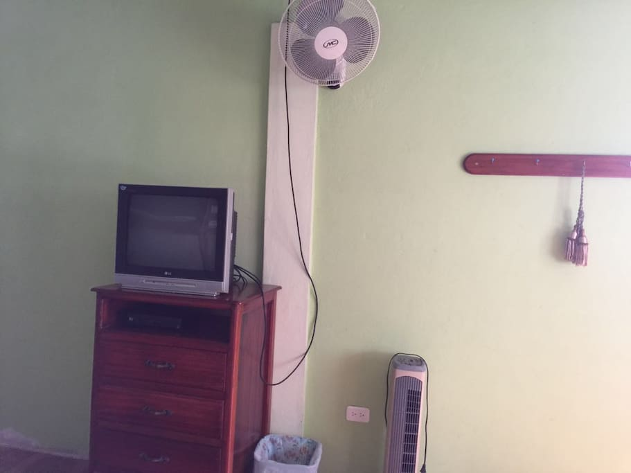 Each room has a TV and fans