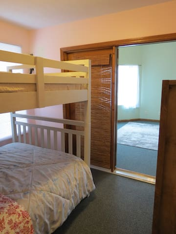 The front bedroom features two full bunk beds and armoire.