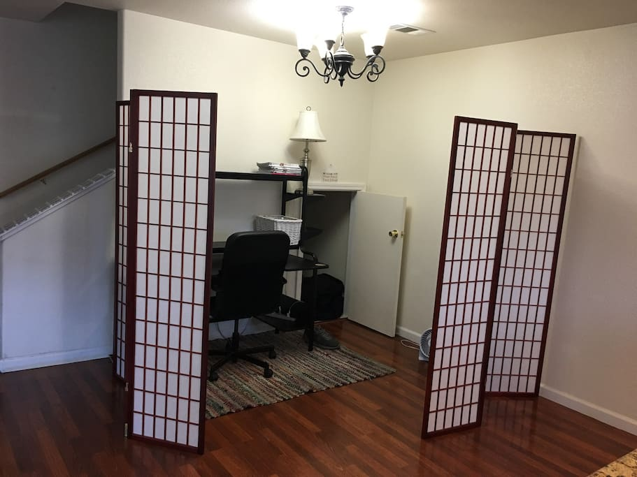 Guest space with room dividers for privacy.