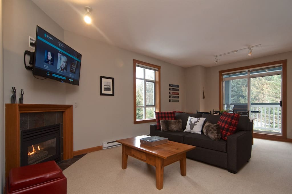 """Spacious living area with fireplace, new 50"""" TV, new sofa bed"""
