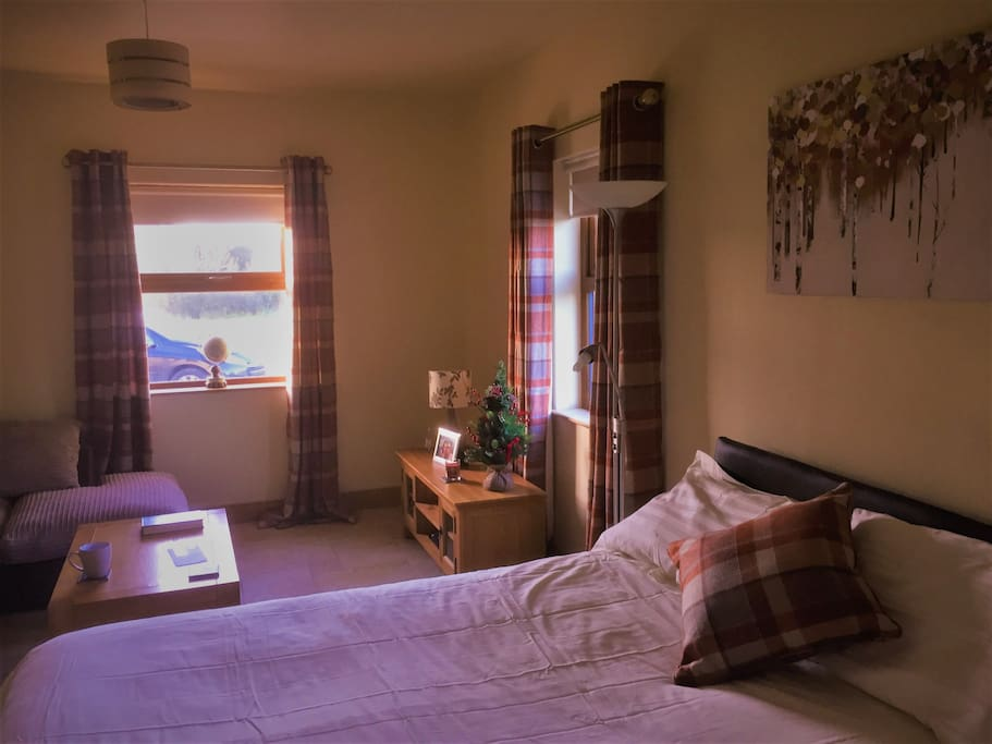 Large bedroom with TV and ensuite