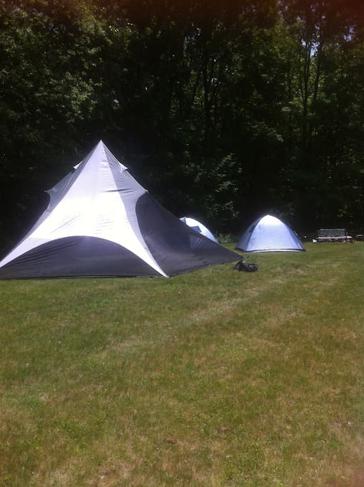 Two 2 person tents, large TIPI in front - TIPI is a separate available booking.