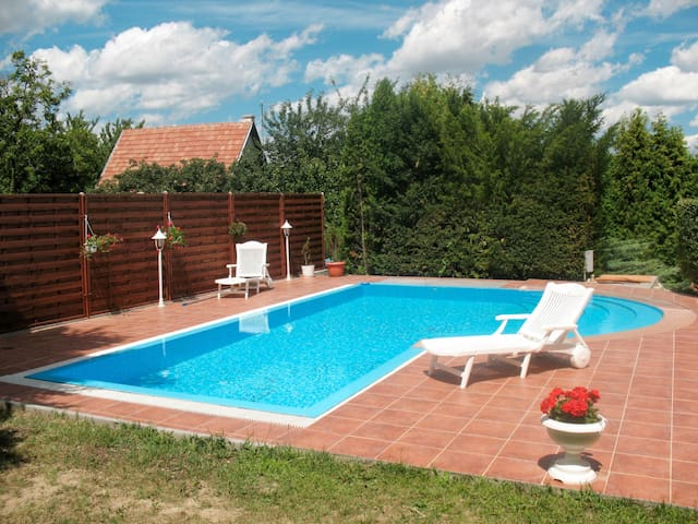 Holiday home with lovely pool and garden on a slight hillside, bordering vineyard