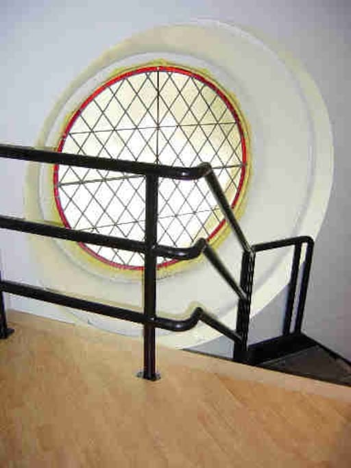 Original Gothic window from 1900 in modern entry
