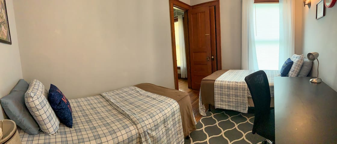 [2nd Bedroom] ...features two twin size beds, a table, chair, closet.