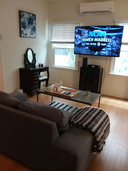 60 inch wall mounted flat screen with Spectrum Cable and Wifi!