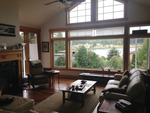 Relax in the living room and enjoy the view of Lone Lake