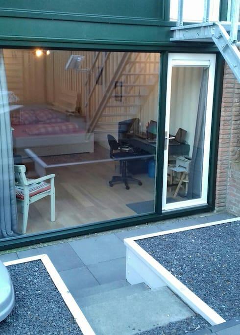 Private entrance via back yard
