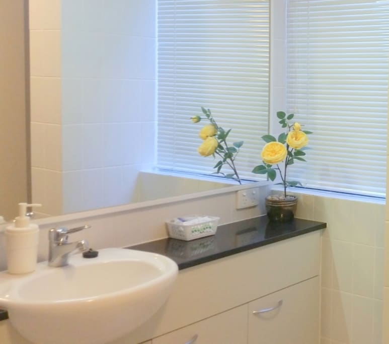Ensuite with bathtub, bath, pool towels, complimentary soap, shampoo, conditioner