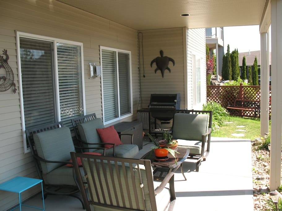 private patio, with comfortable  chairs and bbq.