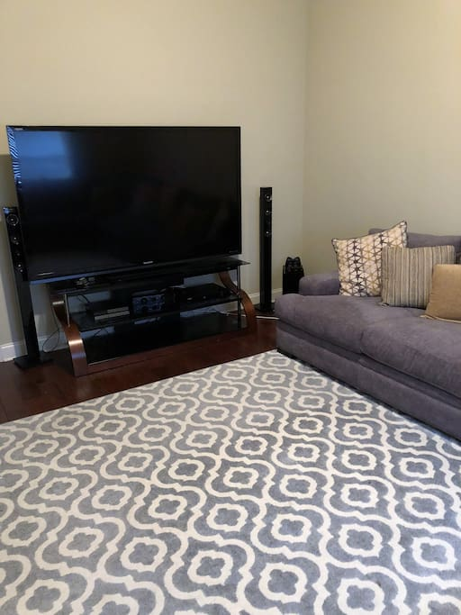 """Media Room with 80"""" TV and Sectional"""