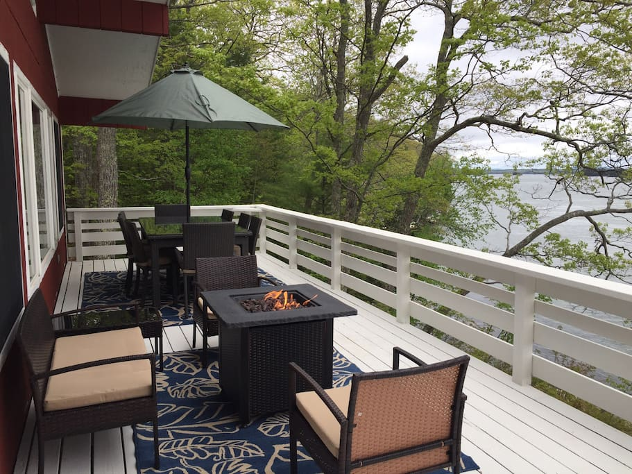 The back deck overlooks the ocean and has a 8 person table plus seating area with propane fire pit and a BBQ grill.