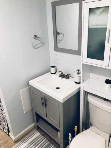 Bathroom - our bathroom is newly decorated.  We offer towel, soap, toilet paper, shampoo, body wash, hairdryer, and curling iron.