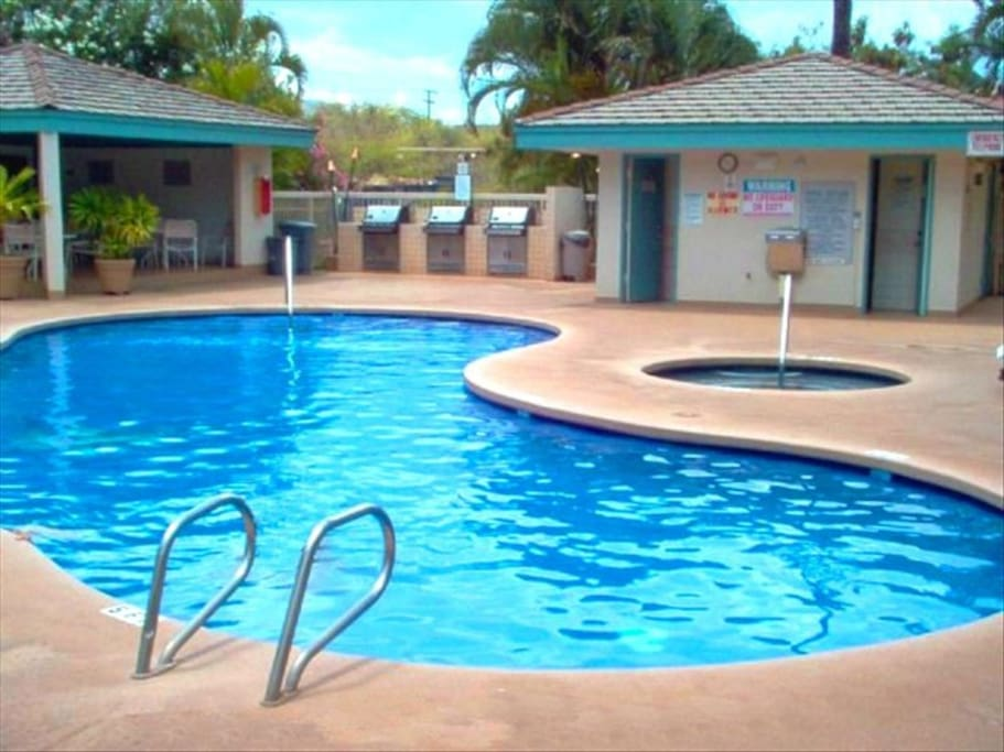 One of 2 identical pool/barbecue areas