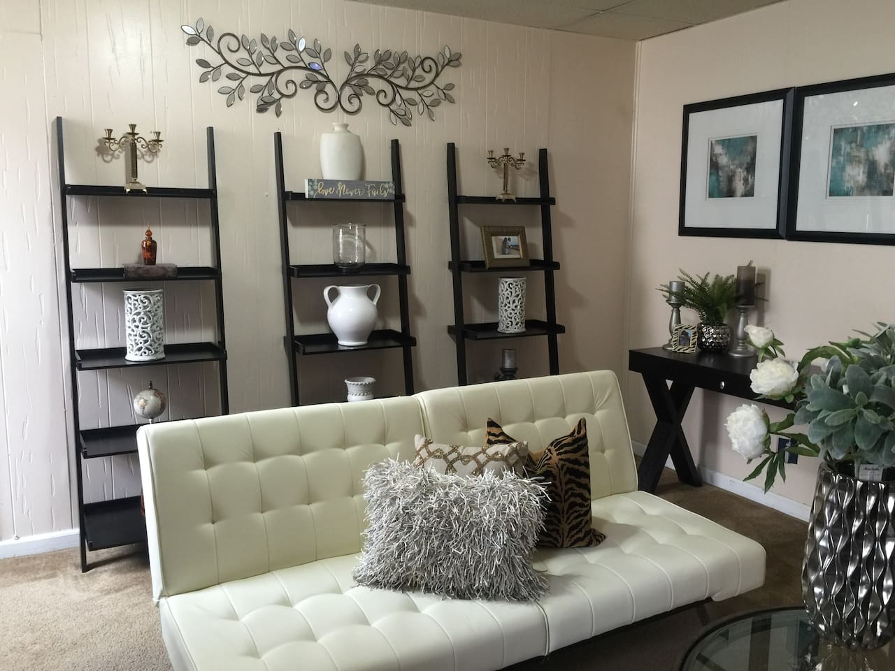 Chic living room with 2 chaise sofas. Sofa can be laid flat and convert to a bed!