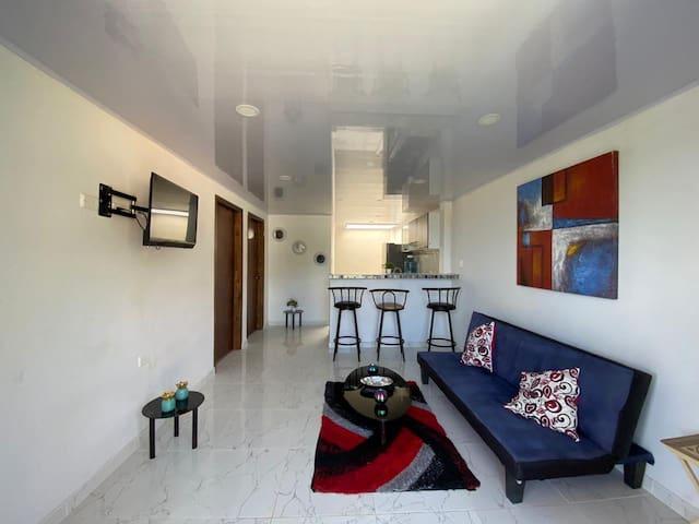 Apartamento con carro mulita gratis medio día.