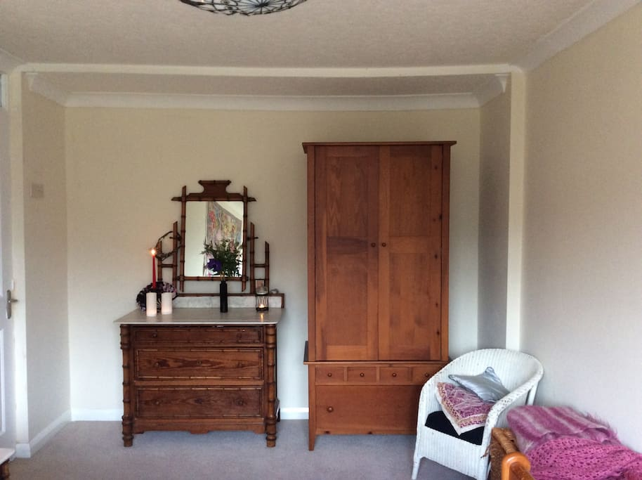 Attractive antique furniture, with plenty of room for clothes.