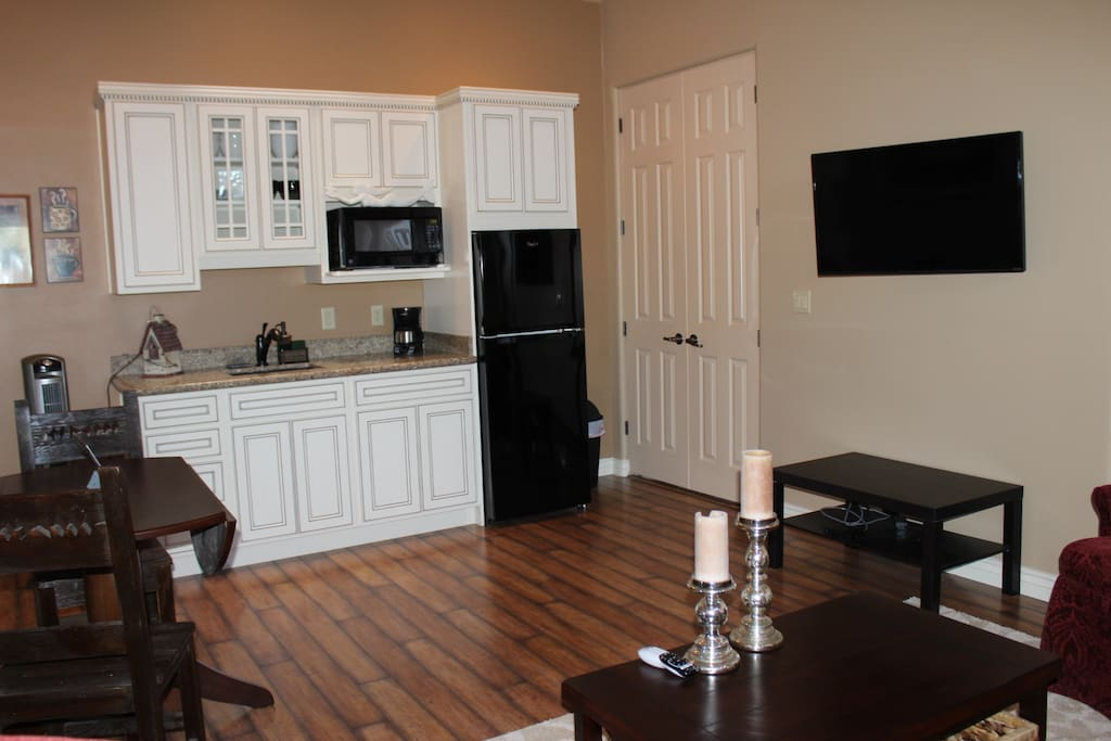 """Your kitchen, pantry and livingroom with 45"""" Flat screen TV"""