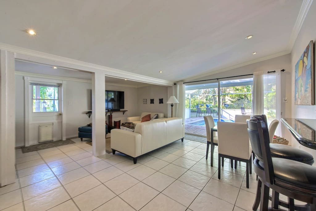 White ceramic tile and wood floors flow throughout the open-concept space