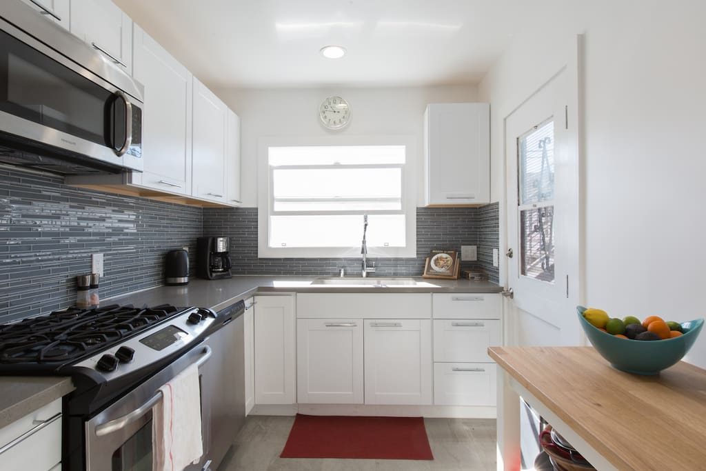 Kitchen - equipped with dishwasher, microwave, toaster, coffee maker, food processor, electric kettle, 4 hob/oven and fridge/freezer