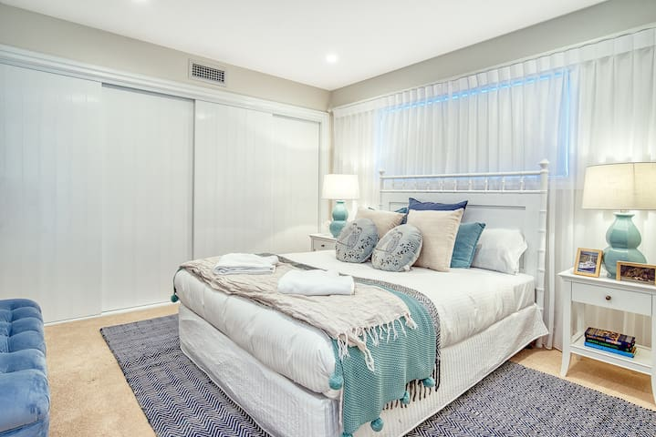 The second bedroom downstairs is also fitted with a comfortable queen-sized bed and features a full wardrobe for hanging and storing clothes.