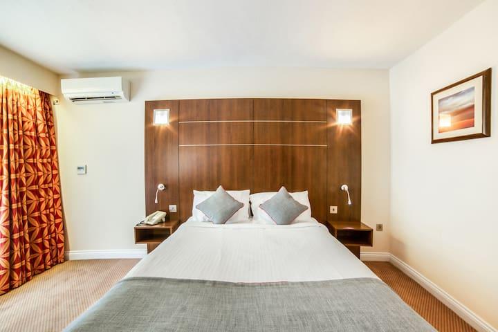 Standard Double Room in OYO The Bridge House Hotel