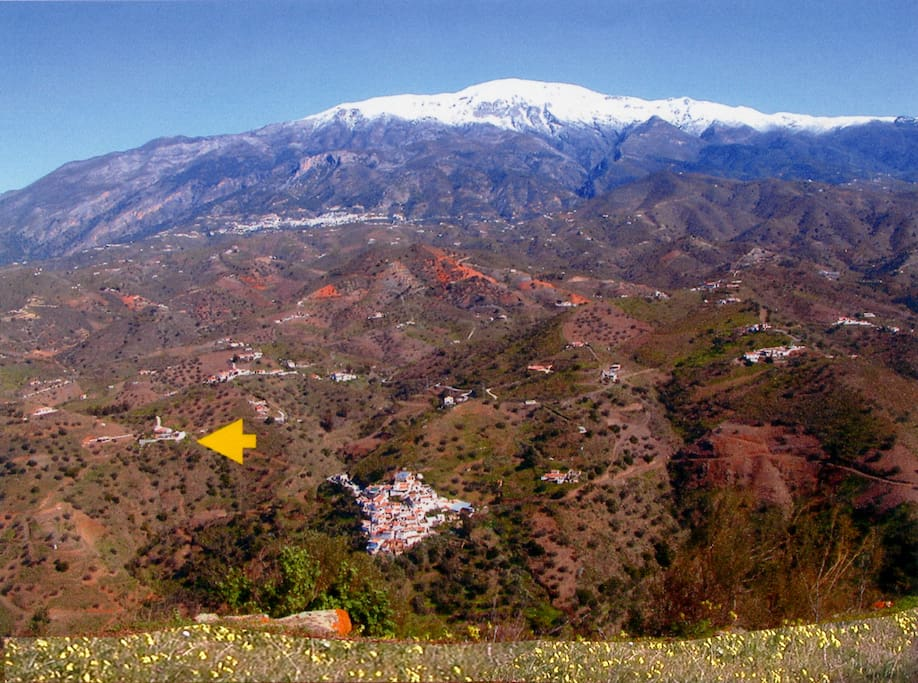 Mountain La Maroma covered in snow and Hacienda Sol marked with arrow