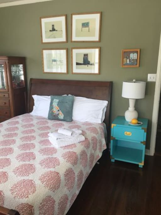 Most current photo, showing bedside table and lamp.