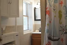 Rainfall shower head, stall shower. Towels and basic toiletries included.