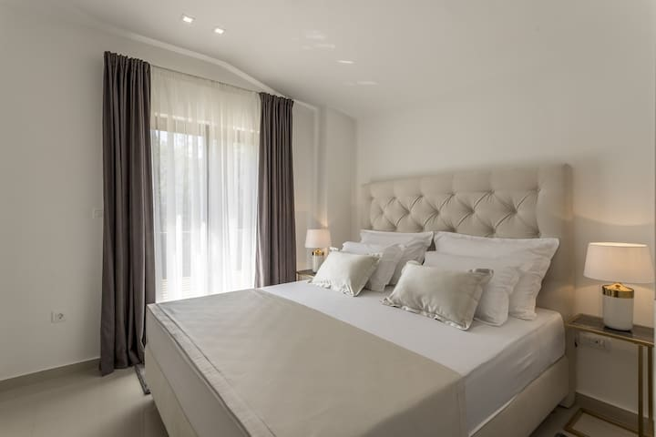 Bedroom No2 with king-size bed 180cm x 200cm, air-condition, a TV  and balcony