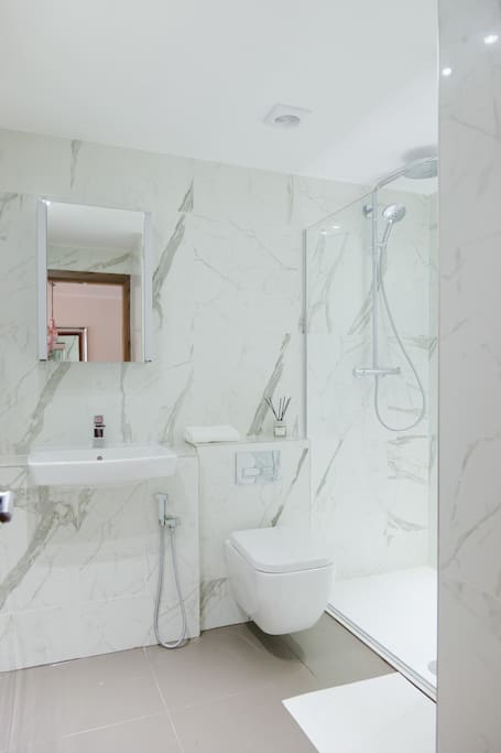 Bright, high quality bathroom with spacious walk in shower