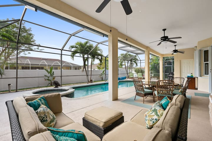 Enjoy sun or shade on the expansive patio, complete with a sectional and a dining table for 6.