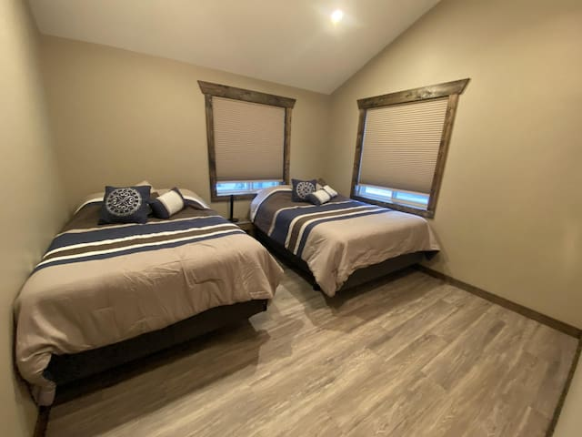 The fourth bedroom has a queen bed and a double bed