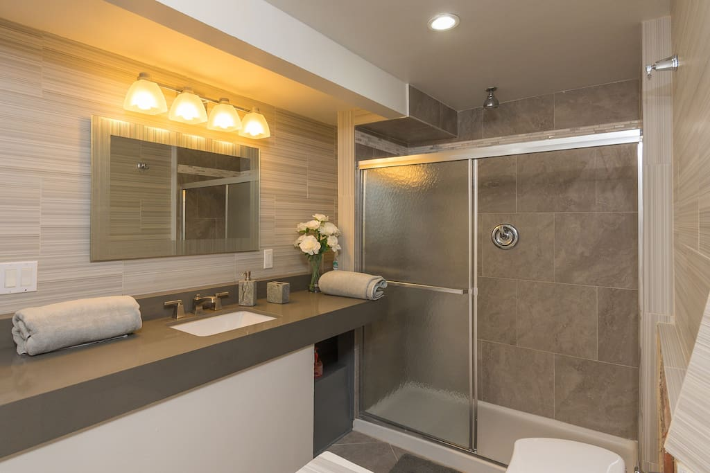 Beautiful, modern, spacious bathroom with standing shower. Towels and toiletries are provided as well. There's a large walking closet next to the bathroom for convenient access.