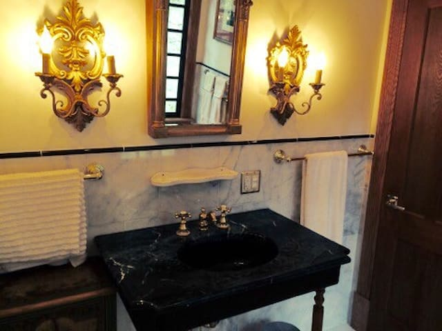 Marble bathroom with tub and shower