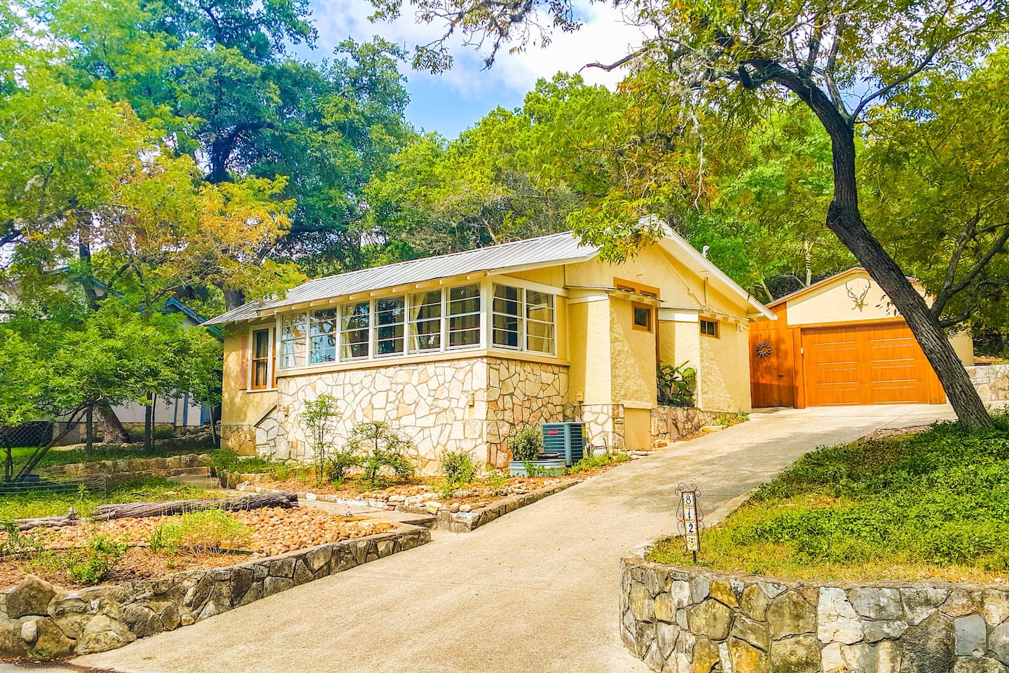 Tanglewood Cottage sits in tranquility on a gentle hillside in one of Kerrville's most unique and eclectic antique neighborhoods.