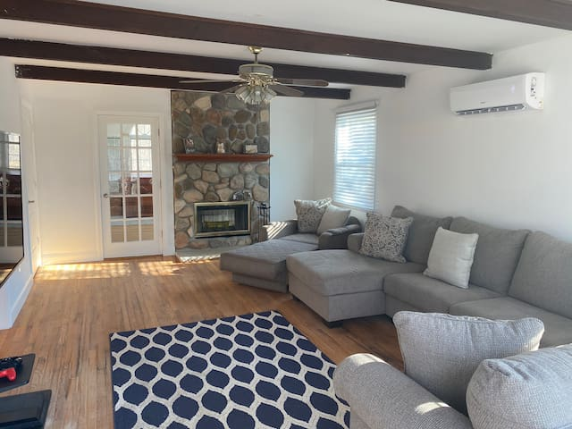 Living room area with double sided fire place.