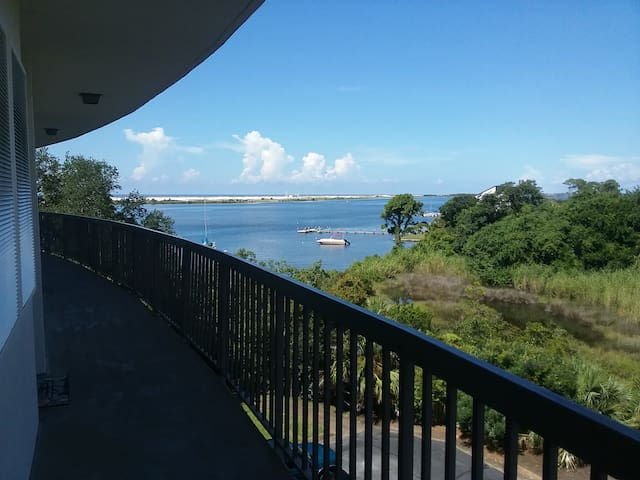 View from the front entrance, looking to the east. Our complex is adjacent to a natural pond, and the opposite shore is beautiful undeveloped barrier island.