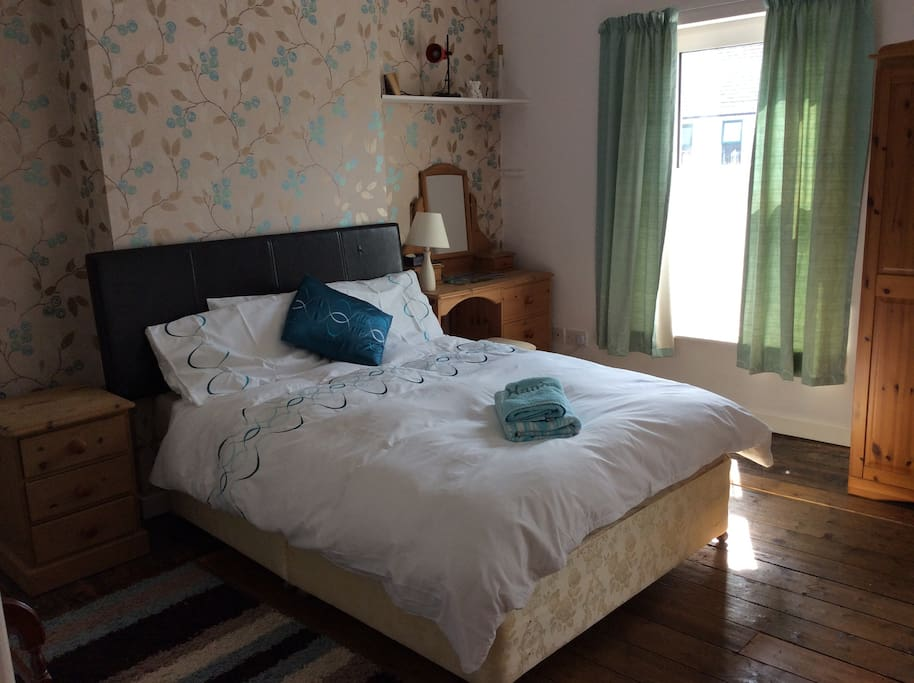Comfortable double room with plenty of space for clothes.